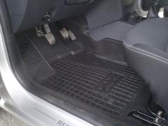 The mats in the car Renault Logan. Car mats in interior Renault Logan